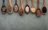 Different types of grains and cereals on shabby concrete background. - 233503533
