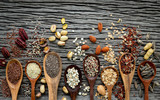 Different types of grains and cereals on shabby wooden background - 233503561