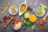 Ingredients for the healthy foods set up on dark stone background. - 233504122