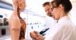 Leinwandbild Motiv Students of medicine examining anatomical model in classroom