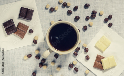 Poster A cup of coffee with corn balls and chocolate