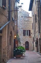 Street of the historical village of San Gimignano, Tuscany, Italy