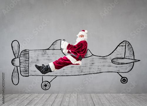 Święty Mikołaj podróżuje samolotem