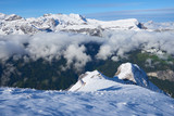 Winter mountain snowy peaks over the clouds in the valley. Jungfrau region in Switzerland.