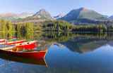 boats on the pier in a mountain lake