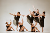 The group of modern ballet dancers dancing on gray studio background - 233572732