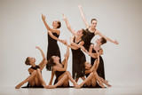 The group of modern ballet dancers dancing on gray studio background - 233572791