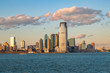 Jersey City from Hudson river during sunset in Jersey City, NJ, USA