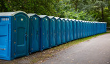 Blue portable chemical toilets wc in the woods - 233575919