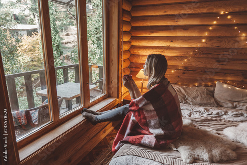 Leinwandbild Motiv Cozy winter weekend in log cabin