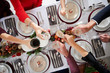 Overhead Close Up View Of People Making Toast Over Table Setting For Christmas Meal At Home - 233580591