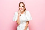 Happy business woman standing and smiling isolated on pink studio background. Beautiful female half-length portrait. Young emotional woman. The human emotions, facial expression concept - 233581721