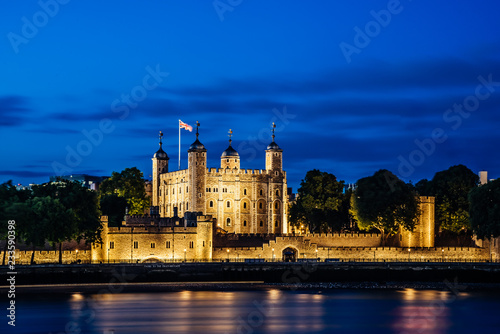Night view of the Tower of London, England across Thames River