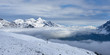 Winter panorama view with clouds in the mountain valley with peaks above. Jungfrau region in Switzerland. - 233617102
