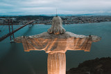 Cristo Rei Christ Statue in Lisbon in the evening time. Aerial view over Lisbon.