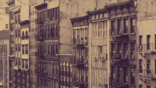 Old buildings in New York City with faded color overlay - 233647570