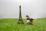Christmas golf ball with Eiffel tower on green grass Paris golfer © thaninee