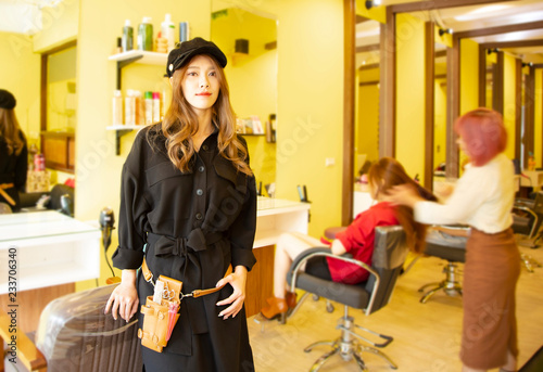 young hairdresser  standing in hair salon