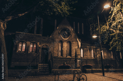 Old Gothic Church in London city by night