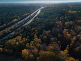 Aerial View of Autumn Forest and motorway at Sunset