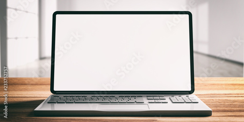 Laptop with blank screen, on a wooden desk, blur empty office background, 3d illustration
