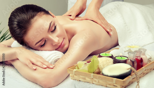 Massage and body  care. Spa body massage   woman hands treatment. Woman having massage in the spa salon for beautiful girl  © Sofia Zhuravetc