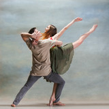Two people dancing in contemporary stile of ballet at studio on gray - 233769559