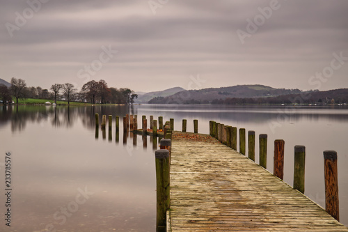 Acrylglas Pier A jetty reflected in Coniston Water, in the Lake District National Park in Cumbria on an autumn day