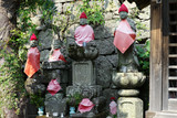 Selective focus buddhist sculptures at Japanese temple and shrine with flowers in vases - 233803326
