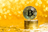 bitcoin coins on a gold background - 233810308