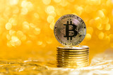 bitcoin coins on a gold background - 233810359
