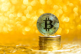 bitcoin coins on a gold background - 233810394