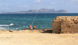 angler use fishing-rod fishing fish in the sea