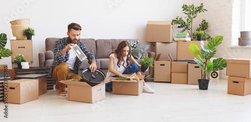 Leinwandbild Motiv - JenkoAtaman : happy young married couple moves to new apartment