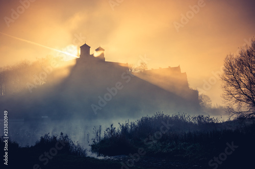 Krakow, Poland, abbey in Tyniec misty sunrise over Vistula river