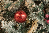 New Year toys and balls in bright decorations and green needles. - 233892973