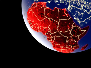 Orbit view of Africa at night with bright city lights. Very detailed plastic planet surface.