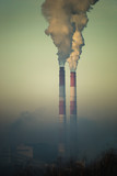 thick smoke comes from the chimney on a frosty day - 233919769