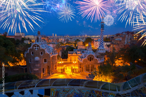 fototapeta na ścianę Gaudi bench and cityscape of Barcelona from park Guell at night with fireworks, Spain