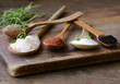 different varieties of salt in wooden spoons