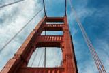 Golden Gate Bridge closeup, perspective of bridge tower support in San Francisco, California. © lucky-photo