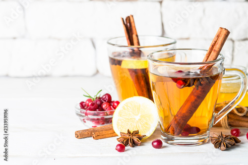 Autumn or winter hot tea with fruit, berries and spices.