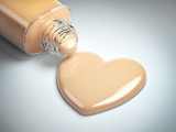 Liquid makeup foundation cream in form of the heart symbol and glass bottle. - 233980393