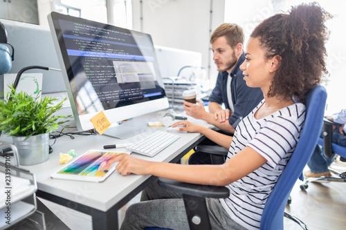 Leinwanddruck Bild Website design. Developing programming and coding technologies.
