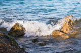 A large waves break against a stones on a shore on sunset. The Red Sea in Hurghada in Egypt. - 234011709
