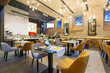 Interior of a modern hotel restaurant with brick wall - 234024942