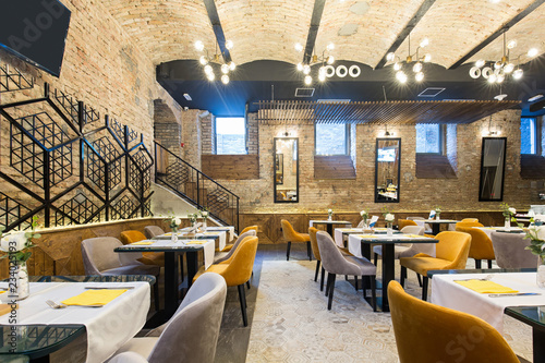 Interior of a modern hotel restaurant with brick wall - 234025193