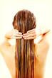 Leinwanddruck Bild - Woman applying hair conditioner. Isolated on white.
