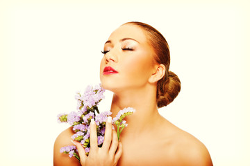 Sensual young spa woman holding flower. © Piotr Marcinski