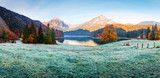 Peaceful autumn view on Obersee lake in Swiss Alps. Frosty grass and mountains reflections in clear water. Nafels village, Switzerland. Landscape photography - 234043315